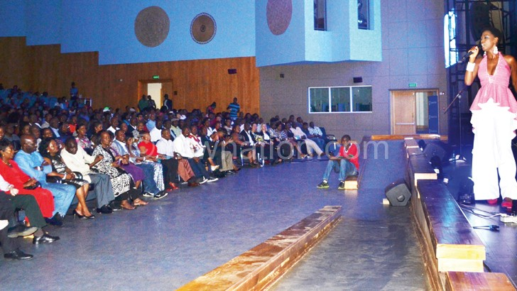 Lira performs for an attentive audience at the Bicc auditorium