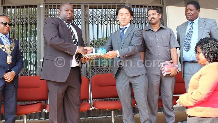 Sakamoto handing over the fire engine keys to Nankhumwa