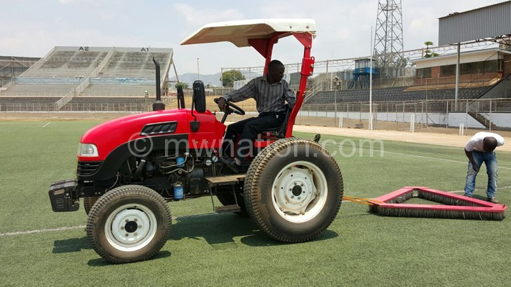 The stadium pitch being cleaned