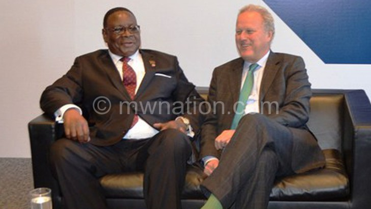 Mutharika is welcomed to the Business Forum panel by Lord Jonathan Marland, chairperson of the Commonwealth Enterprise and Investment Council