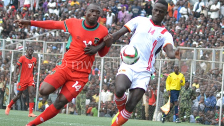 Msowoya (L) challenges a Uganda player during the  July 6 friendly match