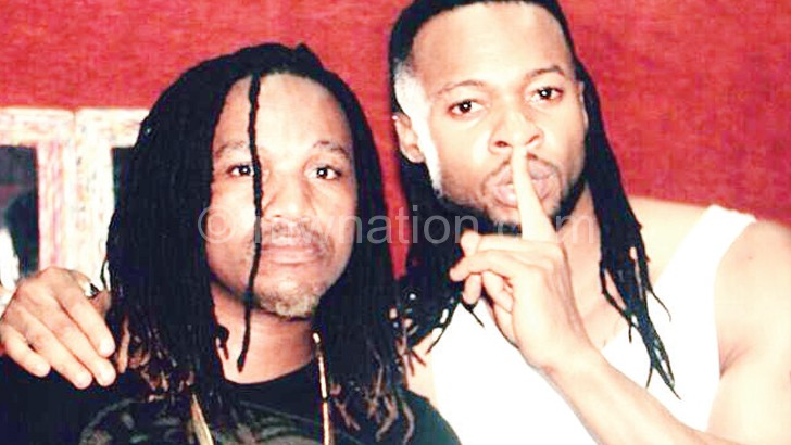 Dan Lu pictured with Nigerian hit-maker Flavour
