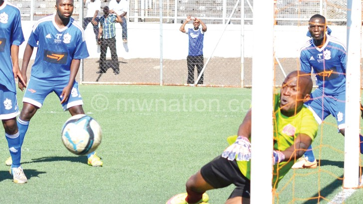 Mafco goalkeeper Frank Kasiyano saves a shot during the match