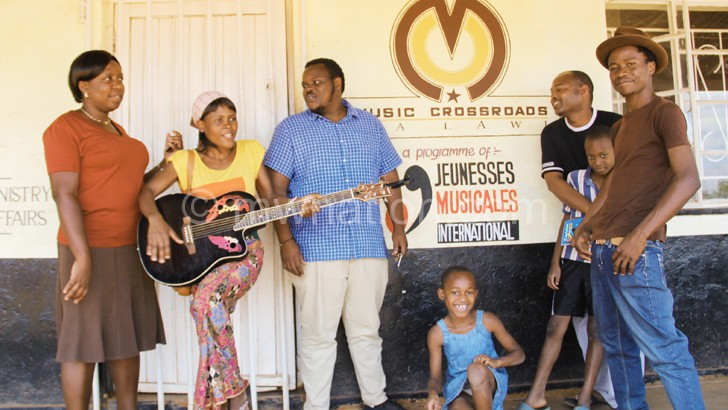 Music Crossroads students and tutors take a break from their lessons
