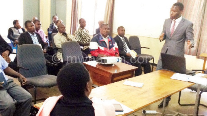 Mwabungulu addressing to district executive  committee (DEC) during the launch