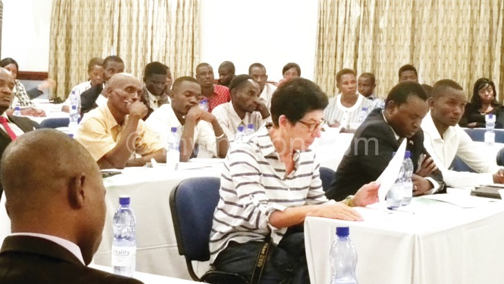 A cross-section of participants following the proceedings