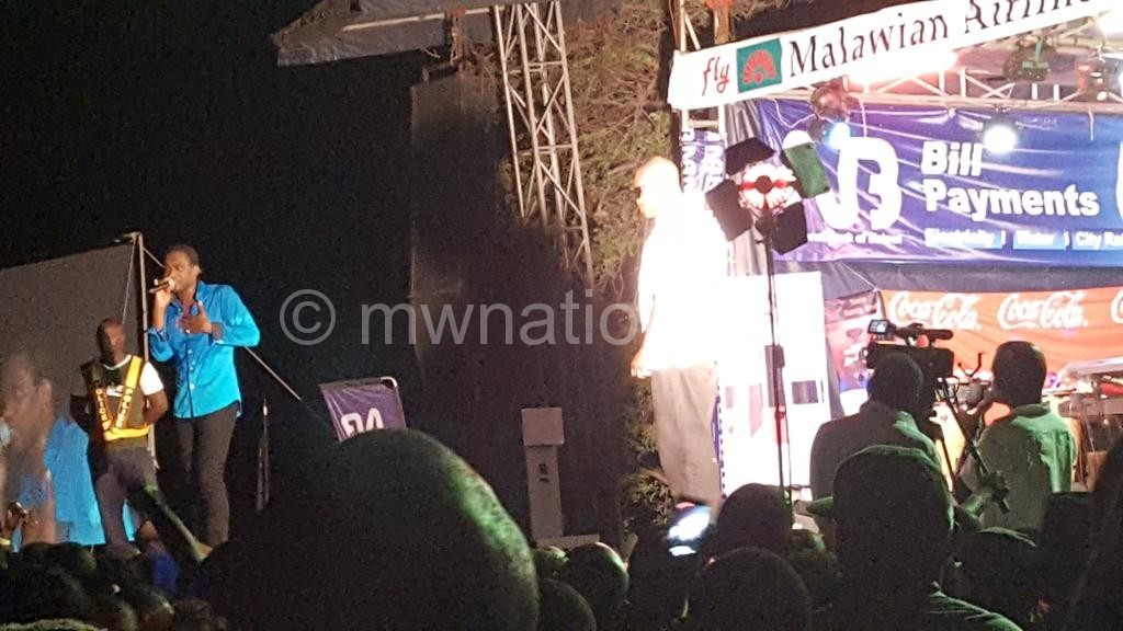 Busy Signal engages patrons during his previous performance in Malawi