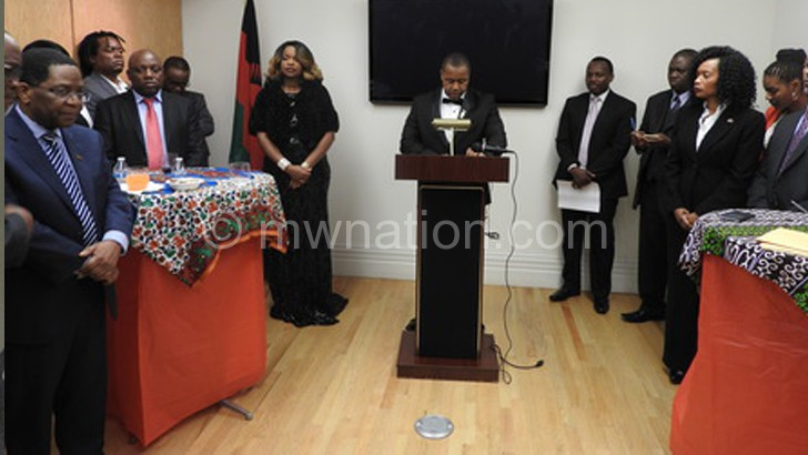 Chilima addressing the meeting in a tiny room at the Malawi Embassy in Washingtone DC
