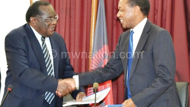 Minister of Finance, Economic Planning and Development Goodall Gondwe and Mpinganjira after sealing the MSB deal