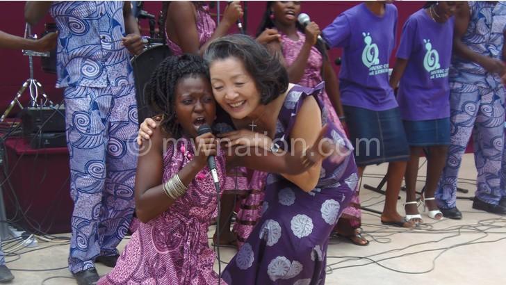 Pressor Chungja Agness Kim (R) with Lusubilo graduate Mwalwanje