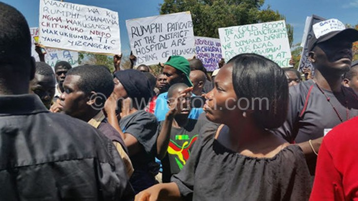 The petitioners hoist placards during their march to Rumphi District Council yesterday