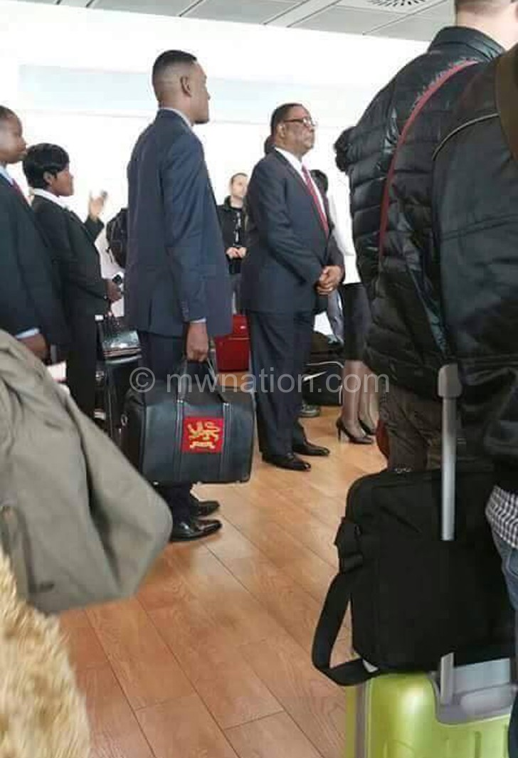 Mutharika waits for his  boarding pass