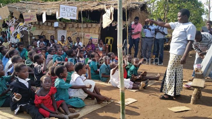 A  Village Camp facilitator teaching children
