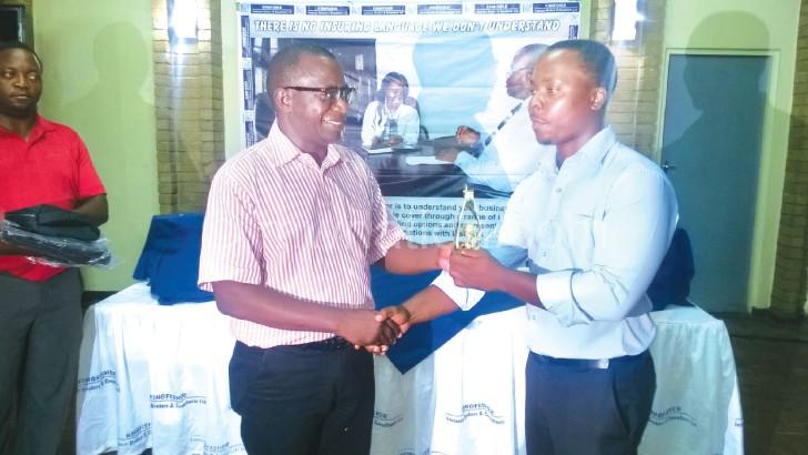 Chimwaza (R) being congratulated by Sisya