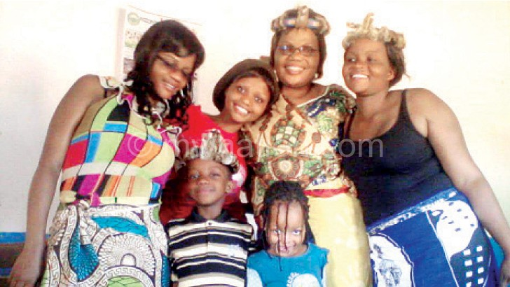 Tembenu (in glasses in the middle) with her family members
