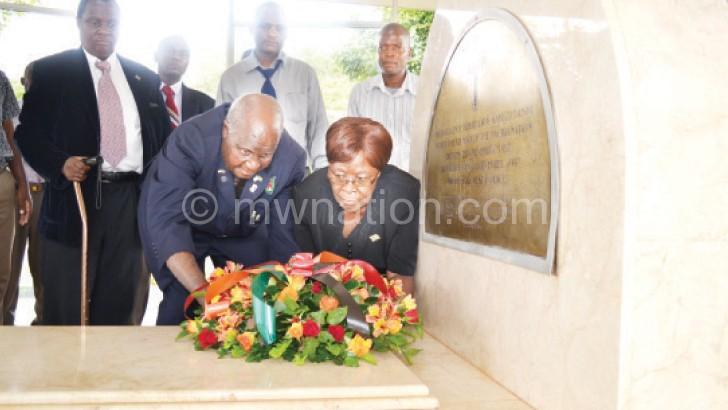 Kaunda laying a wreath on Kamuzu's Mausoleum at the Capital City Centre yesterday.  He is assisted by Zambian High Commissioner Salome Mwananshiku.