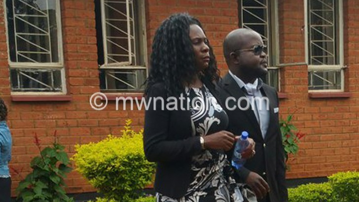 Mphwiyo and his wife, Thandizo, walk out of court yesterday