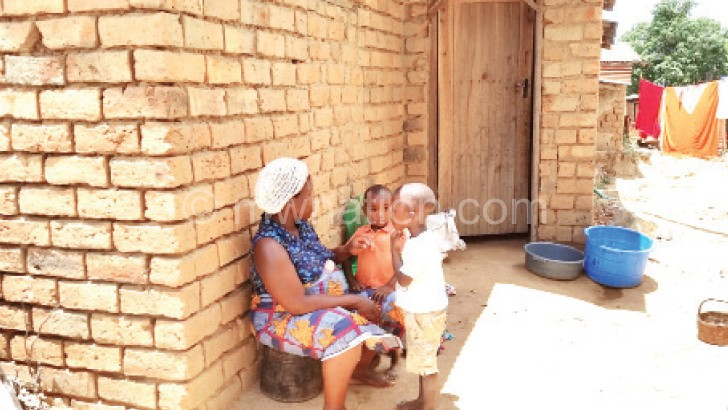 Phiri (L) and her children have nothing special for Christmas