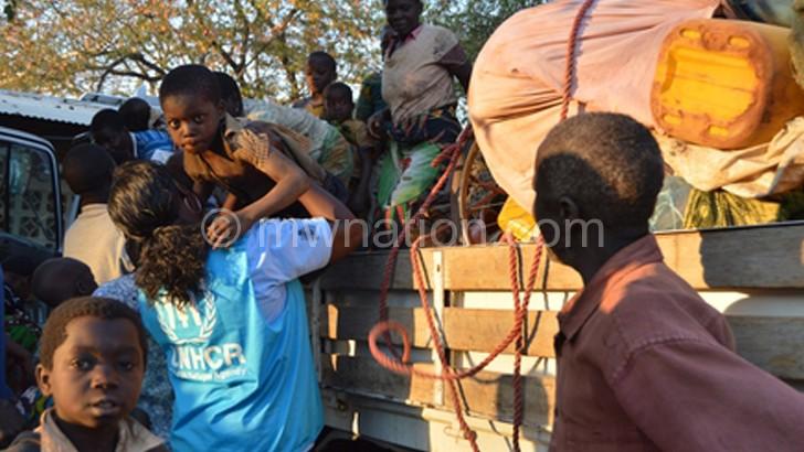 Phiri(standing) interacting with teenage mothers