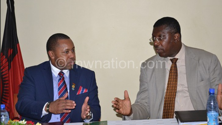 Chilima and Nyarko sharing notes during the forum yesterday