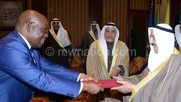 Ali (L) presenting Credentials to Sheikh Sabah Al-Ahmad