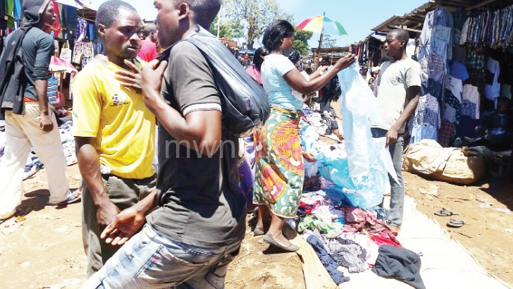 Shoppers sample second-hand clothes  at Limbe Market