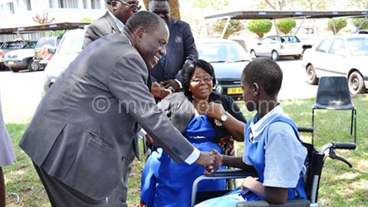 Chimombo congratulating a pupil
