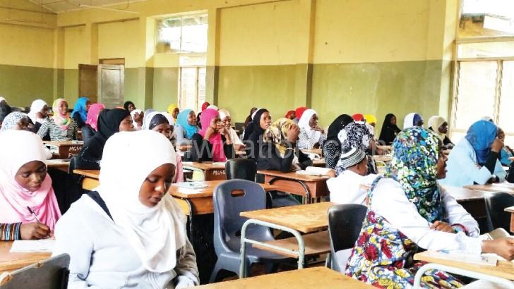 Mulism girls listening to a presentation in Mzuzu