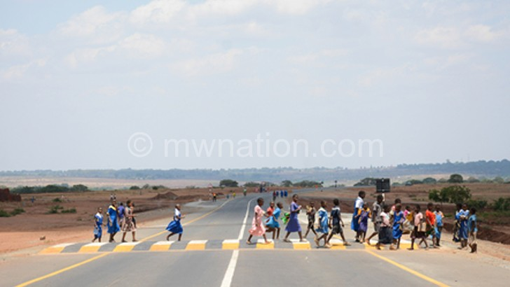 School children crossing the road at a zebra crossing