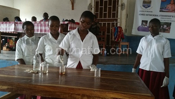 Girls from St Lawrence Girls Catholic Secondary School conducting a science experiment during the event.