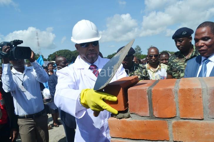 Chilima laying a foundation stone