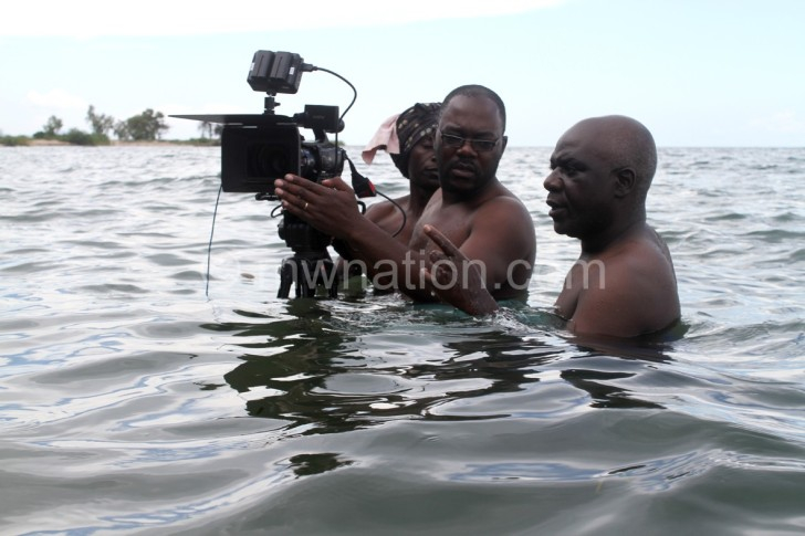 The crew shares notes during shooting of The Last Fishing Boat