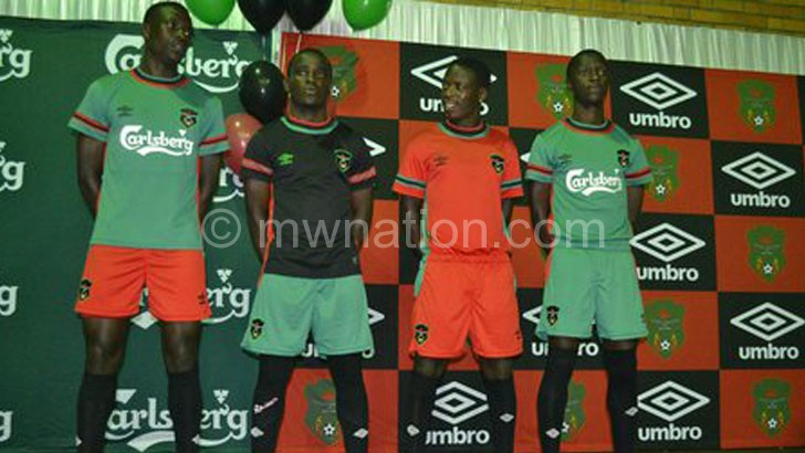 Flames players show off the Umbro jerseys during the launch