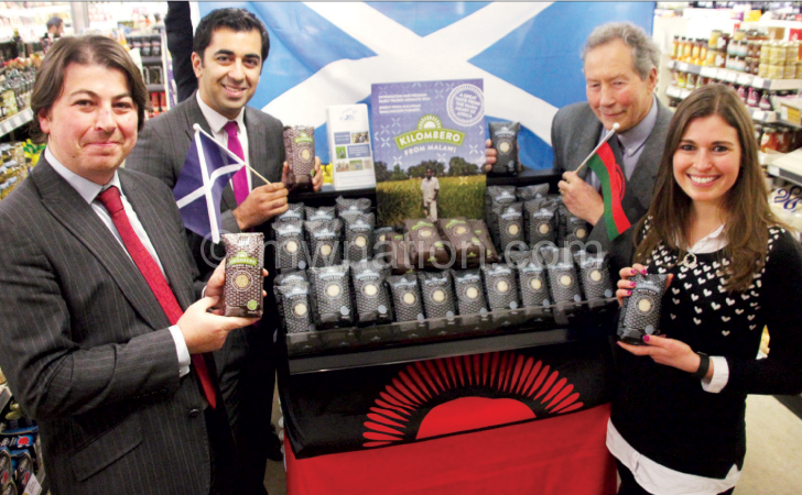 Yousaf (with Scottish flag) and JTS officials at the launch of rebranded Kilombero product