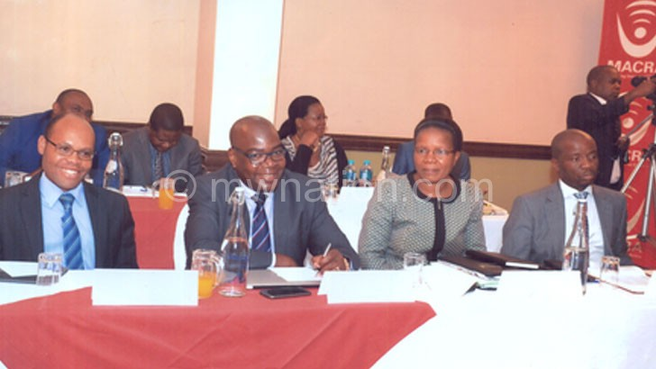Itaye (R), NSO commissioner of statistics Mercy Kanyuka, Macra deputy director general Francis Bisika and Macra director of finance and administration Ben Chitsonga (L) follow proceedings