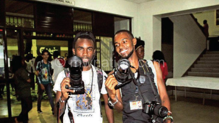 Ron CZ (L) captured with a colleague as they prepare to shoot a video