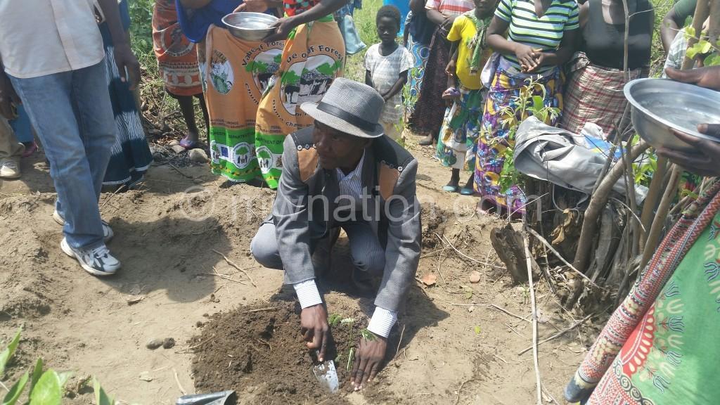 T/A Kunthembwe planting a tree