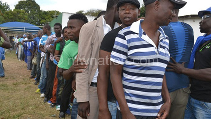 Chamangwana's supporters queue behind him during last elections