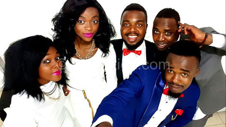 Faith Mussa (in blue) and his band
