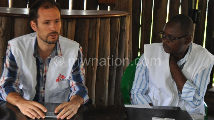 Gregoire (L) making a point as MSF Advocacy and Communications Manager Benedicto Chinsakaso looks on