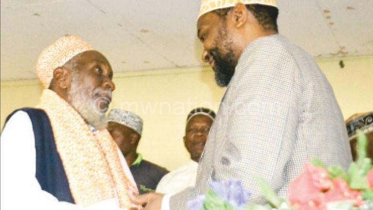 Mufti Cassim (L) welcomes Muhammad at Pankambiri Lodge