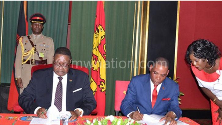 Mutharika and Joseph Mwanamvekha, Minister of Industry and Trade