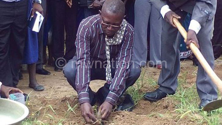 Chimwaza planting a tree during the launch