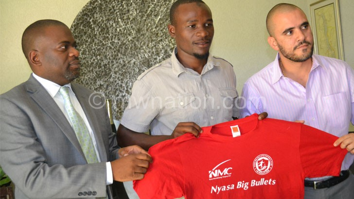 New catch: Sulumba (C) being unveiled at by  Bullets chairman  Chilunga