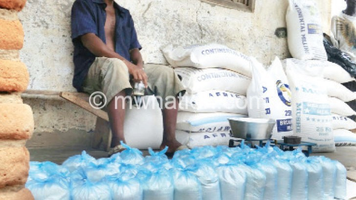 Well-stocked: A vendor ready to sell his imported maize