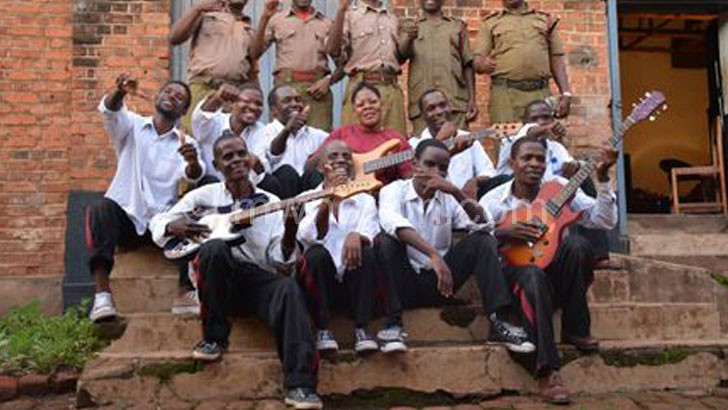 Zomba Prison Project band pose with their jailers