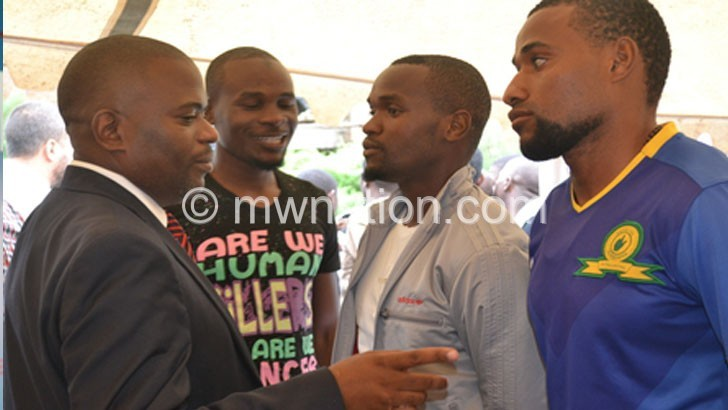 Chilunga (L) interacts with the 'new signings' Sulumba (2ndL), Zoya (R) and Lanjesi
