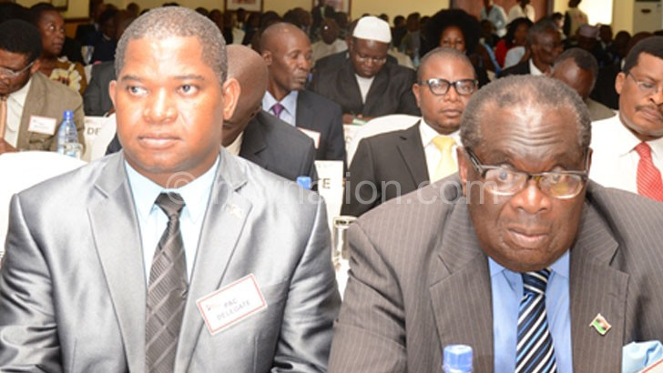 Magalasi (L) and Gondwe listening to concerns raised at the meeting