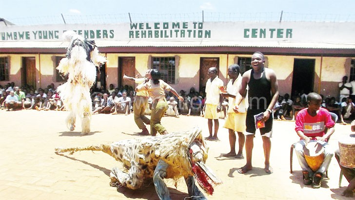 The young inamtes show off their gule wamkulu dance during an open day at the facility