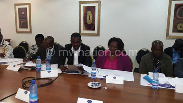 Social commentator Oliver Nakoma (C) reading the statement to the media